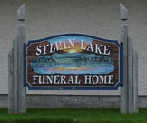 SYLVAN LAKE FUNERAL HOME logo